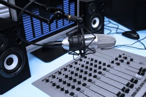 7168524 - a mic in front of the control panel and screen in broadcasting studio